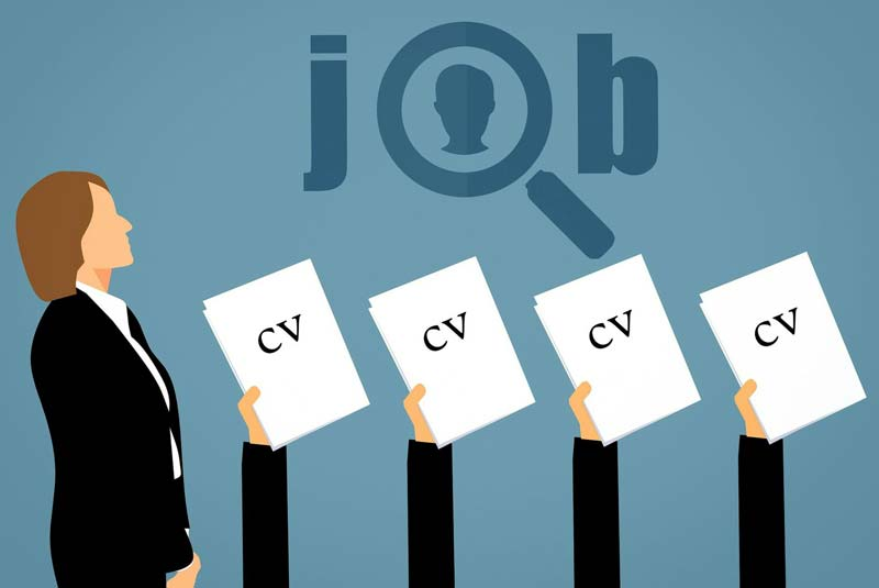 employer overlooking several held-up CVs